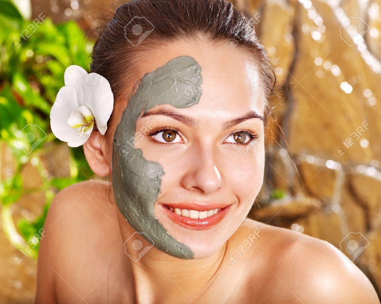 Beautiful girl having clay facial mask apply by beautician. Stock Photo - 12340938