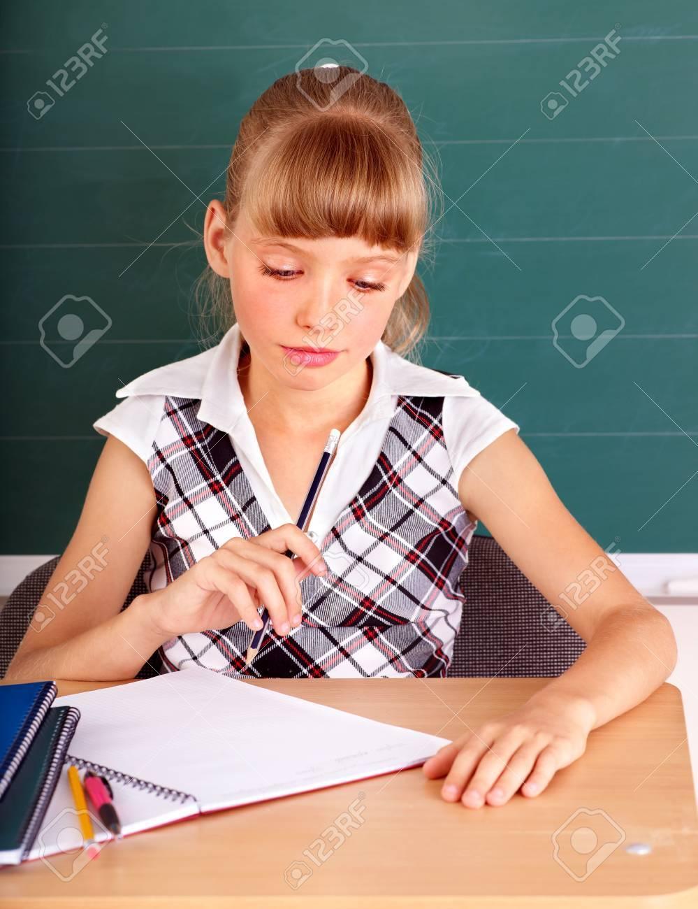 Happy schoolchild in classroom near blackboard. Stock Photo - 12340878
