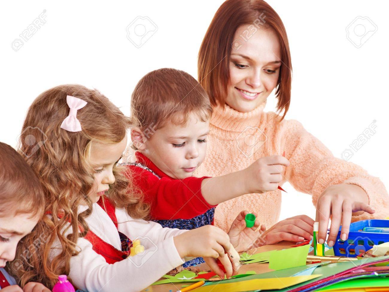 Kindergarden teacher with group children. Isolated on white. Stock Photo - 12340879