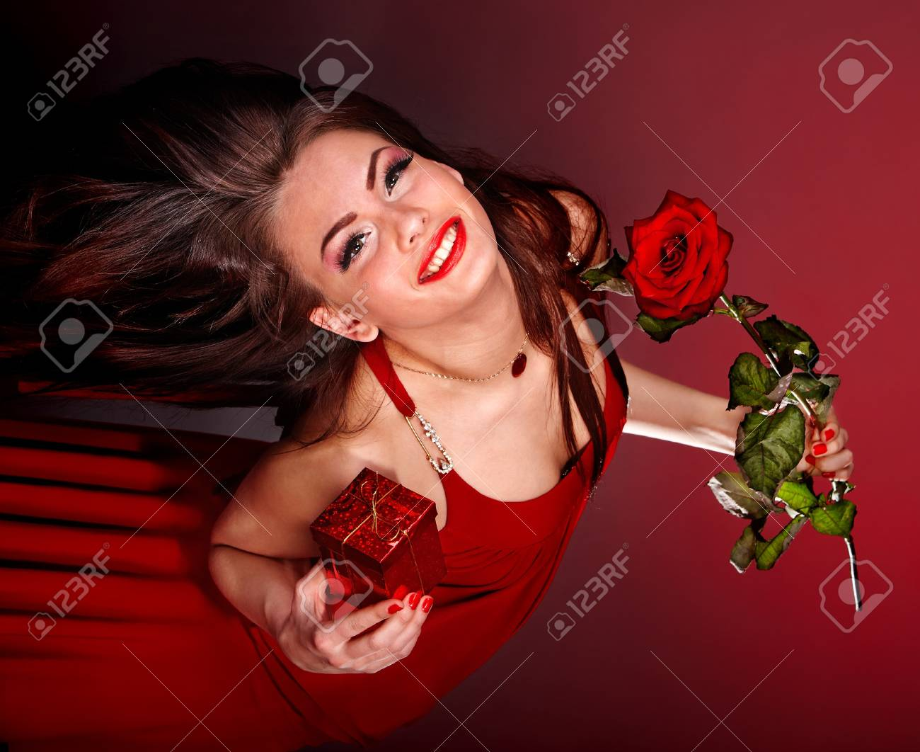 Young Woman With Flower And Gift Box Valentine S Day Stock