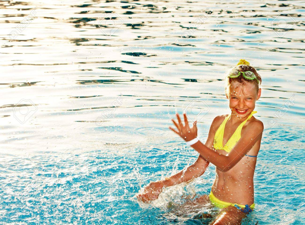 Little girl in swimming pool. Summer outdoor. Stock Photo - 13258485