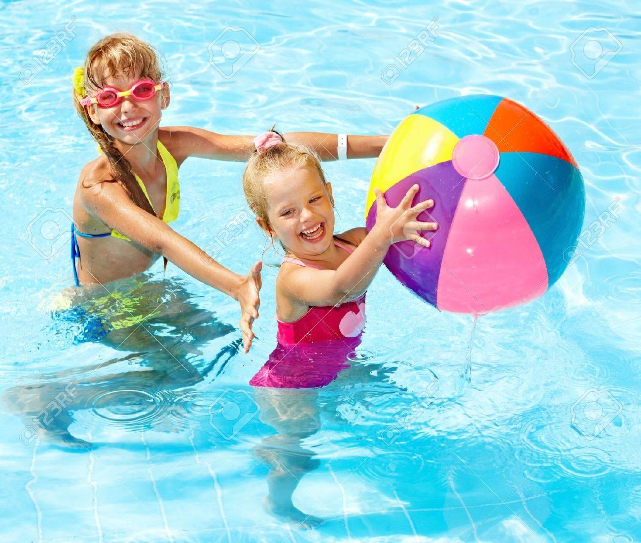 Little girl  swimming in pool. Stock Photo - 13310018