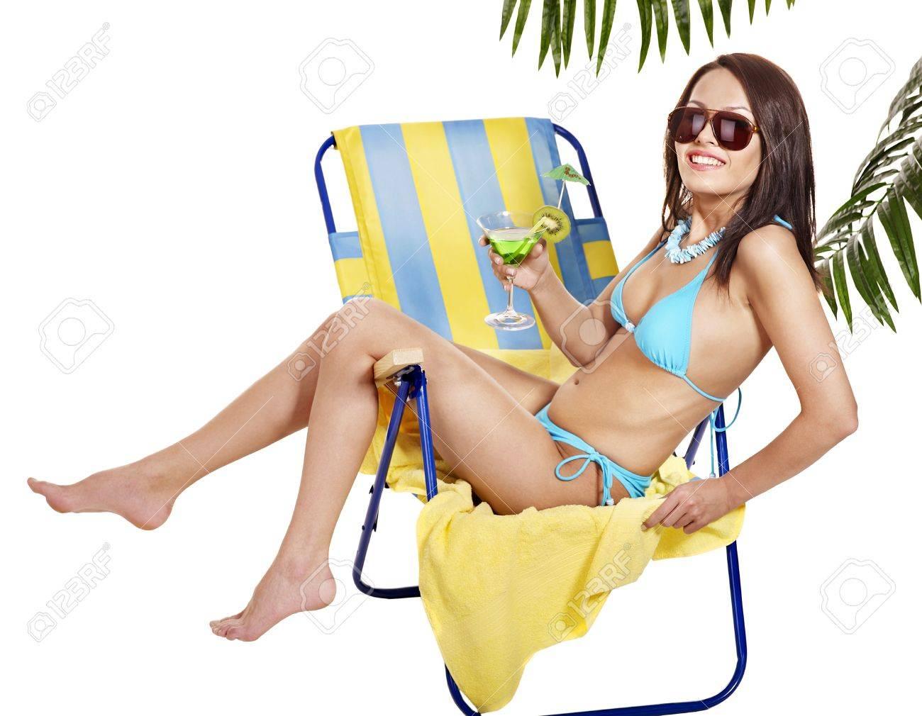 Girl in bikini drink juice through  straw. Isolated. Stock Photo - 13561429