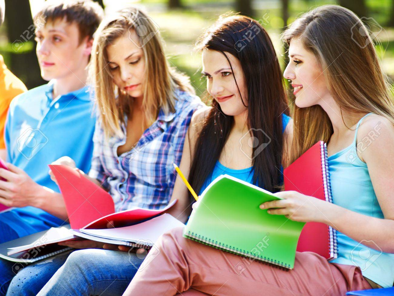 Group student with notebook on bench outdoor. Stock Photo - 13563098