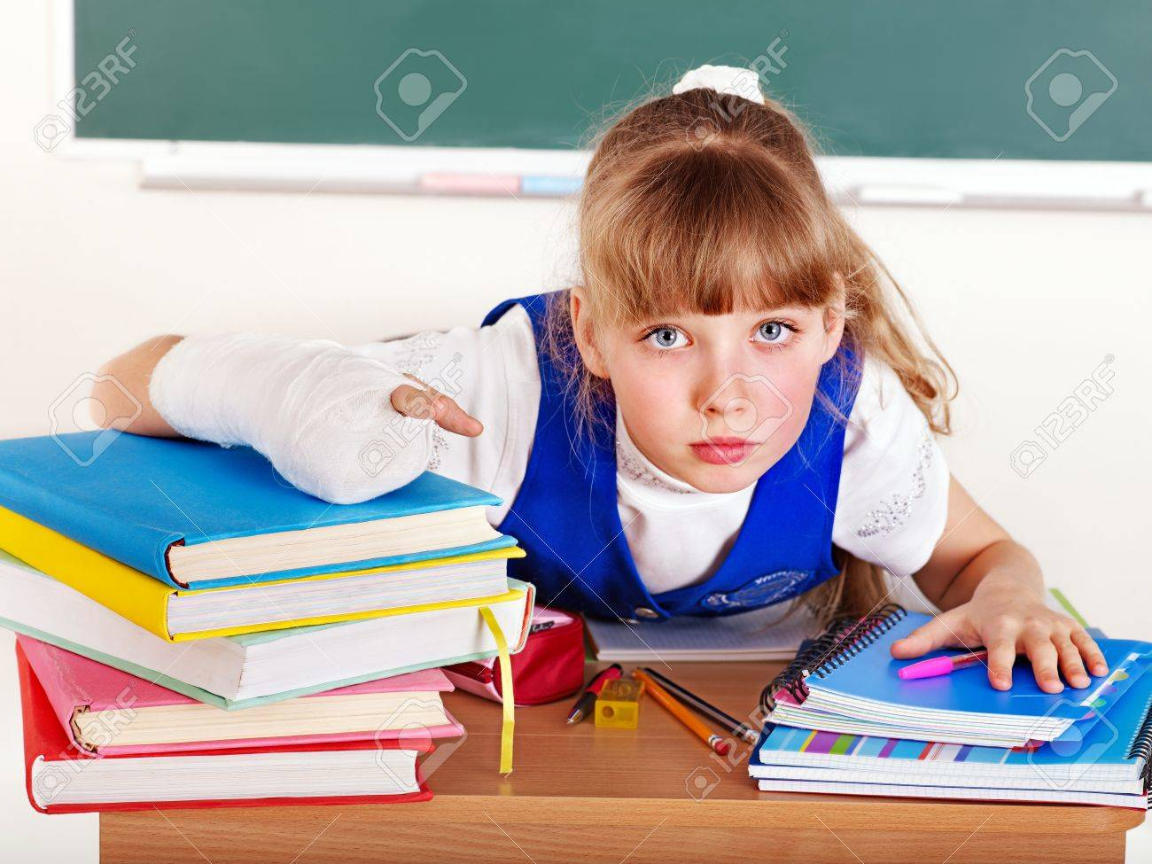 Disabled child with broken arm in classroom. Stock Photo - 13852011