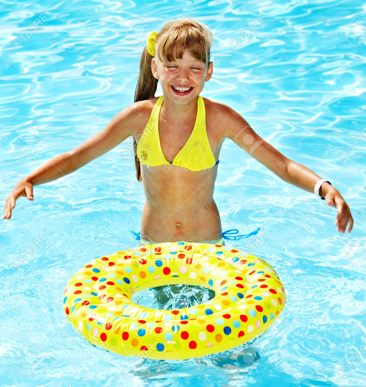 Little girl in swimming pool. Summer outdoor. Stock Photo - 14084446