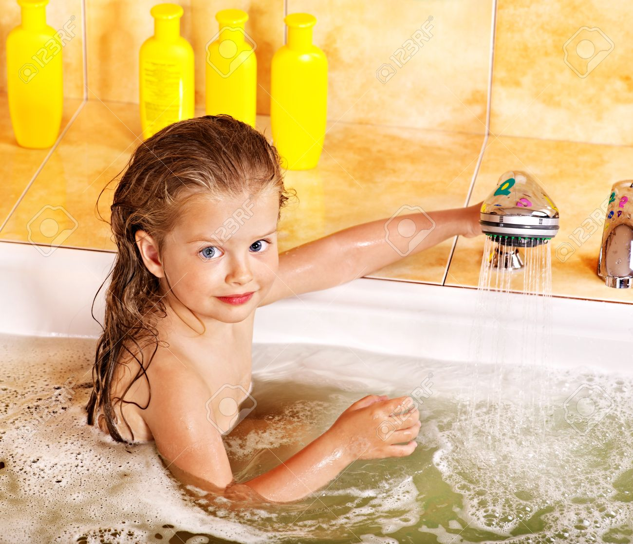 Children in shower Stock Photo - Happy child bathing in bubble bath .