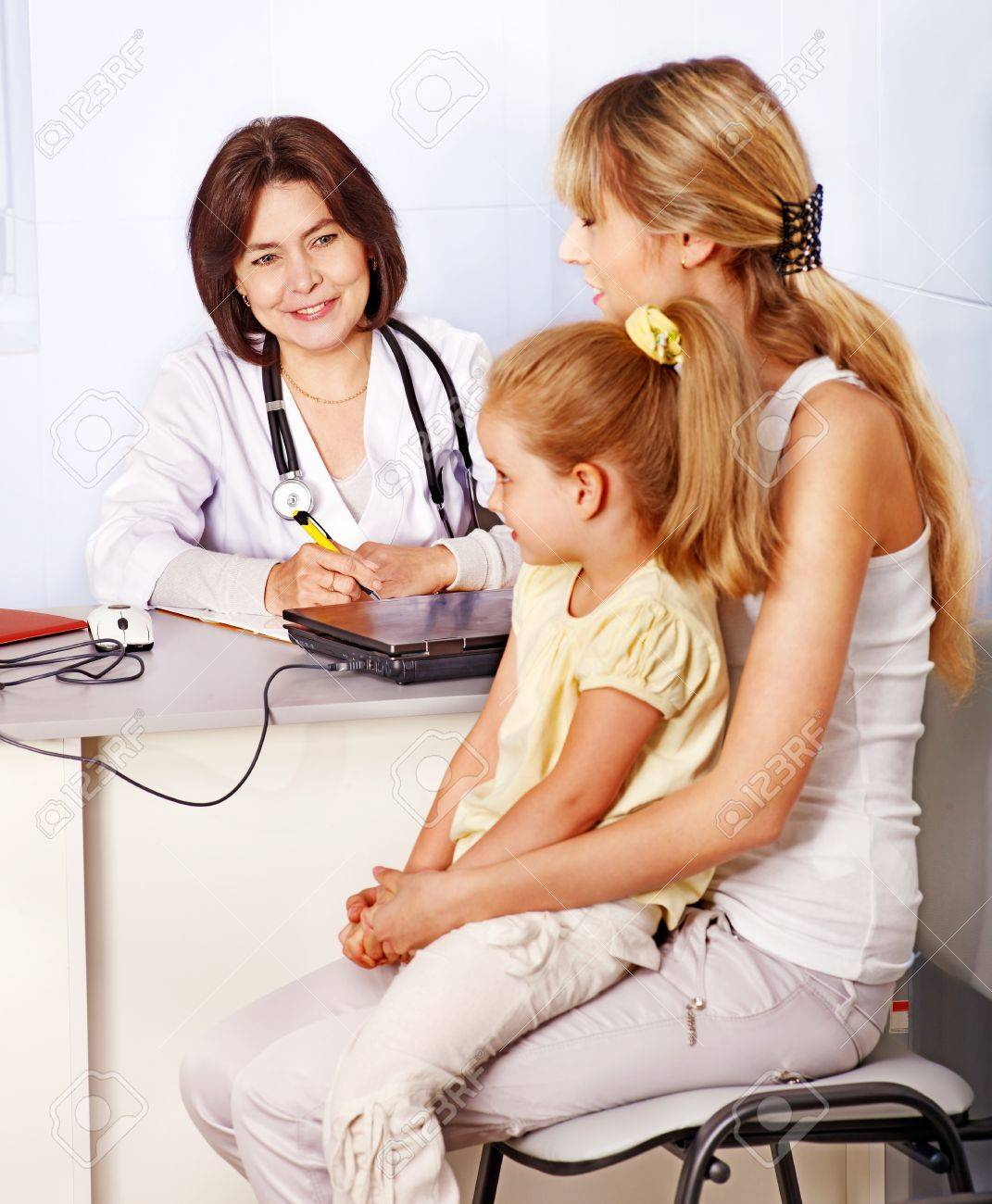 Happy family on reception at doctor. Stock Photo - 14535748