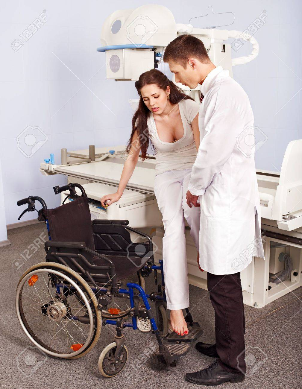 Doctor checking patient  in x-ray room. Stock Photo - 14531341