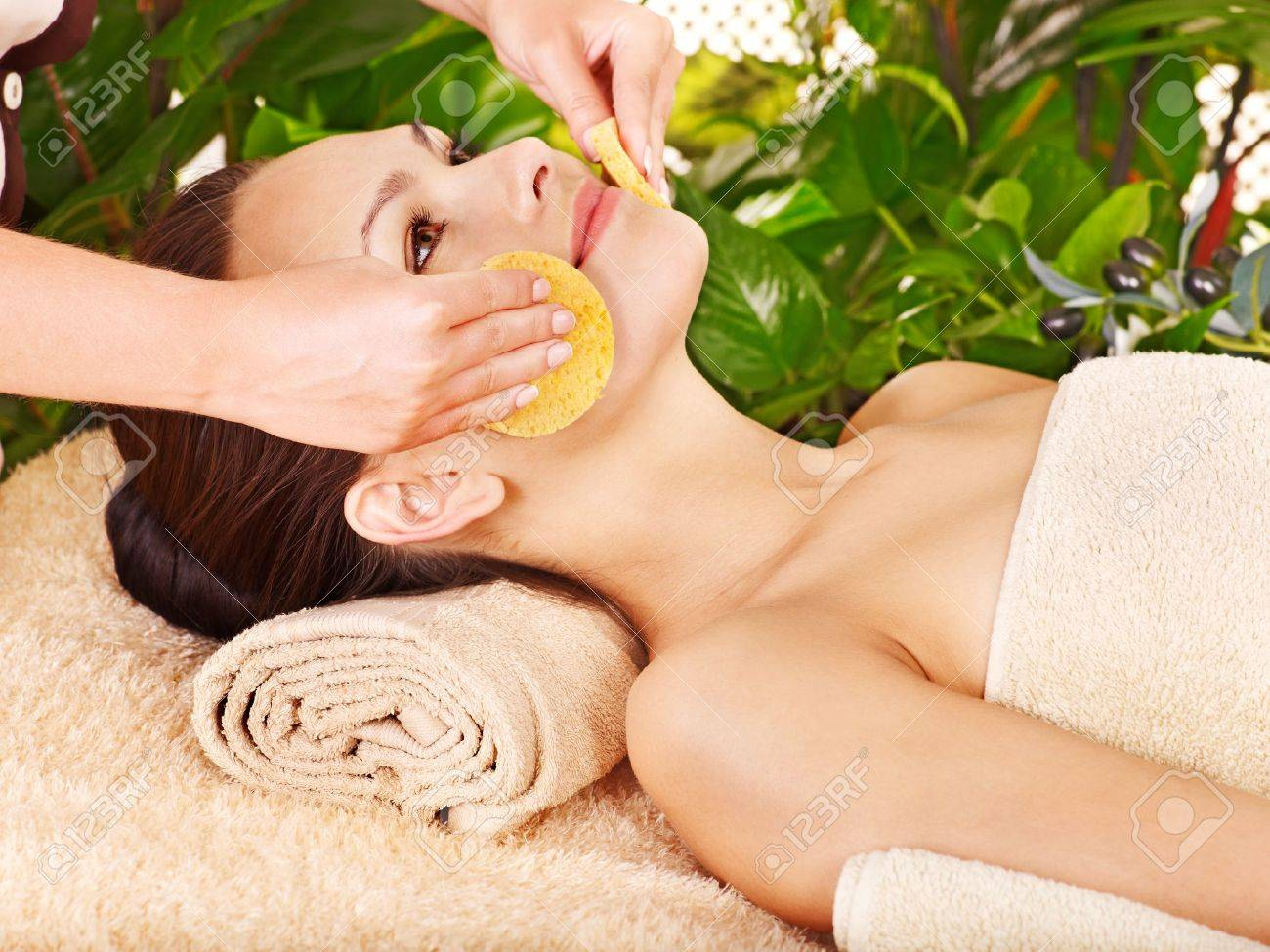 Woman Getting Facial Massage In Tropical Beauty Spa Stock Photo