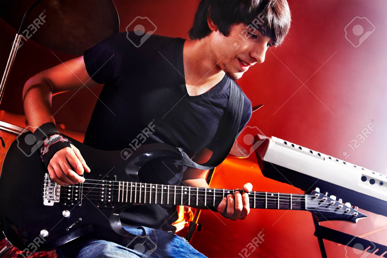 Man playing  guitar in night club. Stock Photo - 14741779