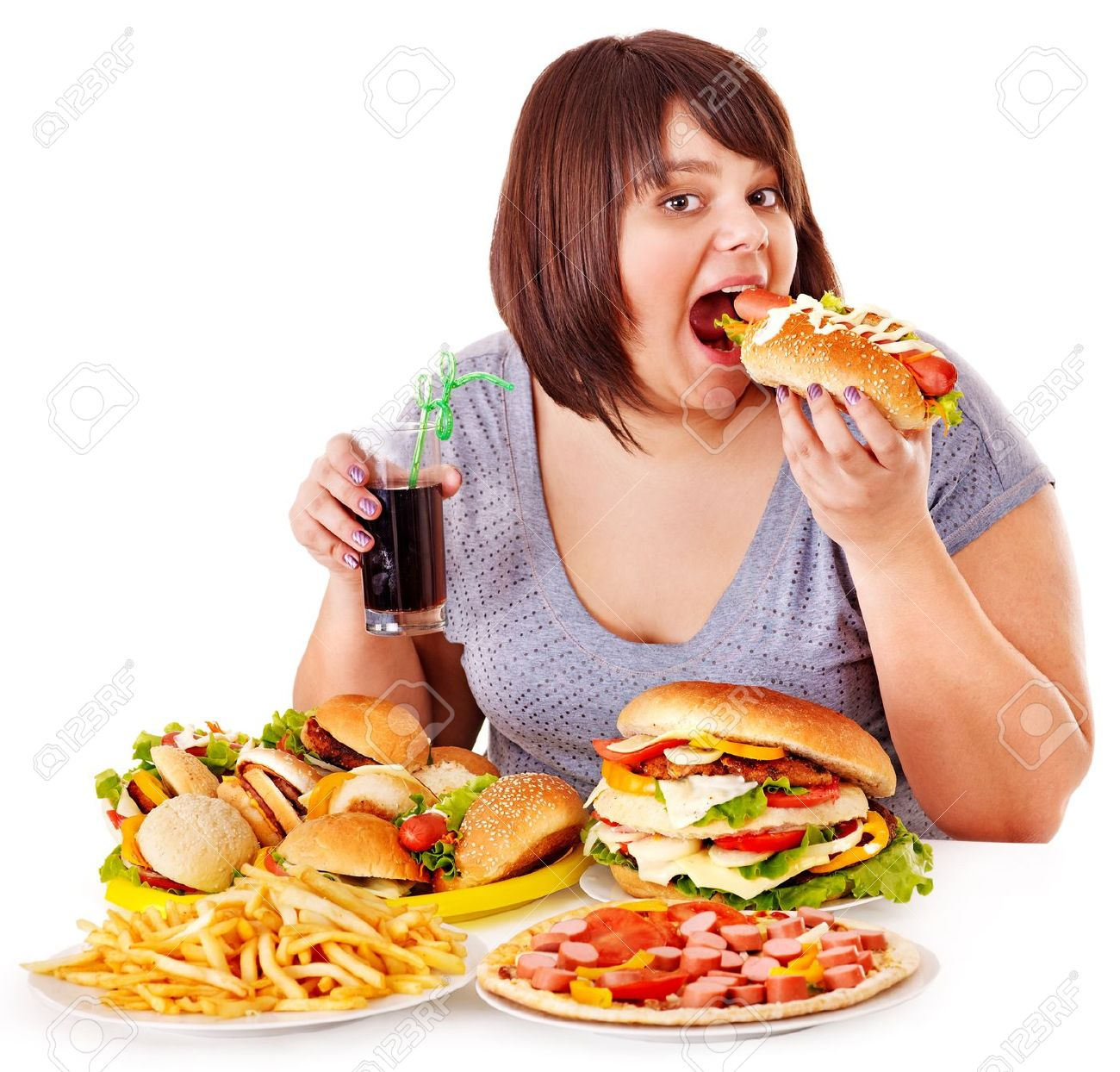 Overweight woman eating fast food. Stock Photo - 15231877