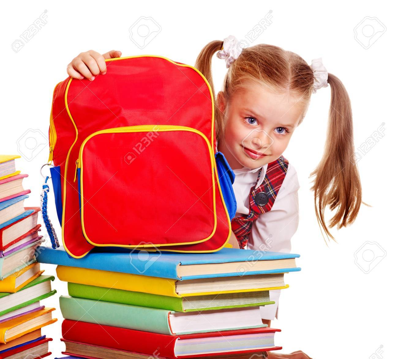 Child with red backpack holding book. Isolated. Stock Photo - 15231874 5495265dcadea