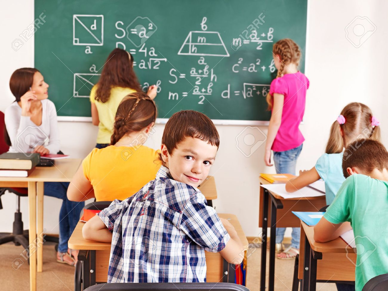 School child with teacher in classroom. Stock Photo - 15232600