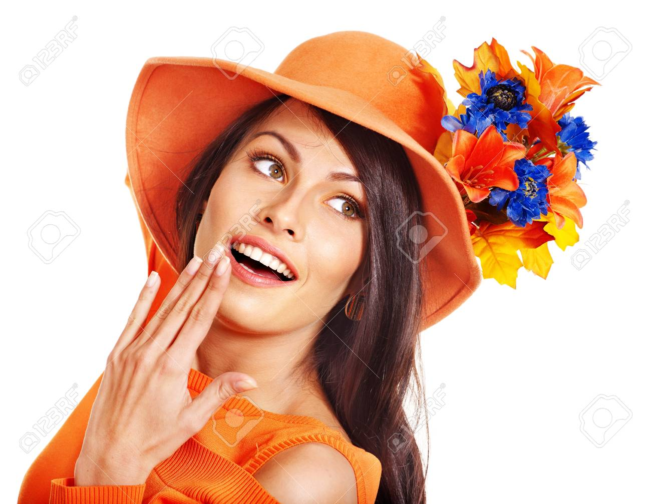 Woman wearing orange hat with flower. Isolated. Stock Photo - 15290469