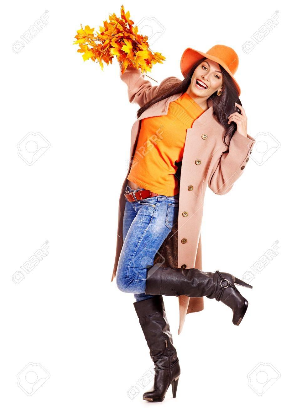 Woman wearing overcoat holding  orange leaves. Stock Photo - 15290217
