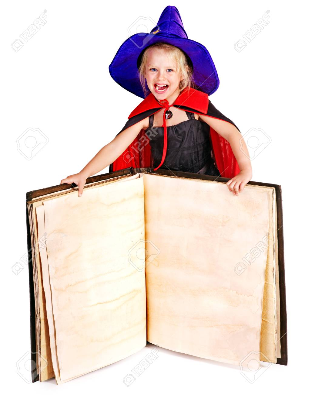 Witch little girl holding  book. Isolated. Stock Photo - 15455275