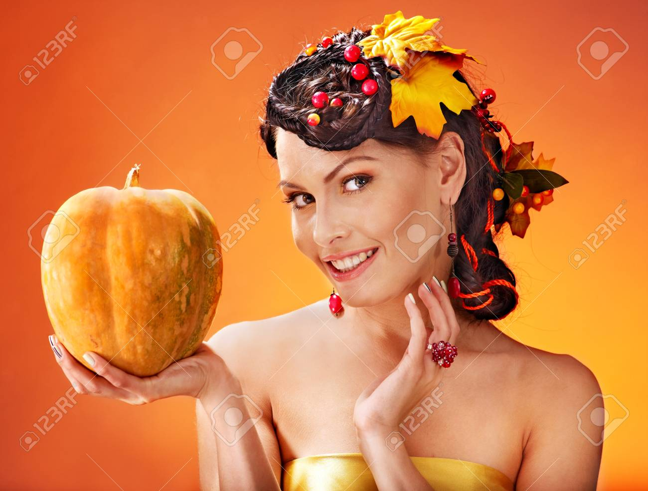 Woman holding autumn pumpkin and leaves. Stock Photo - 15464677