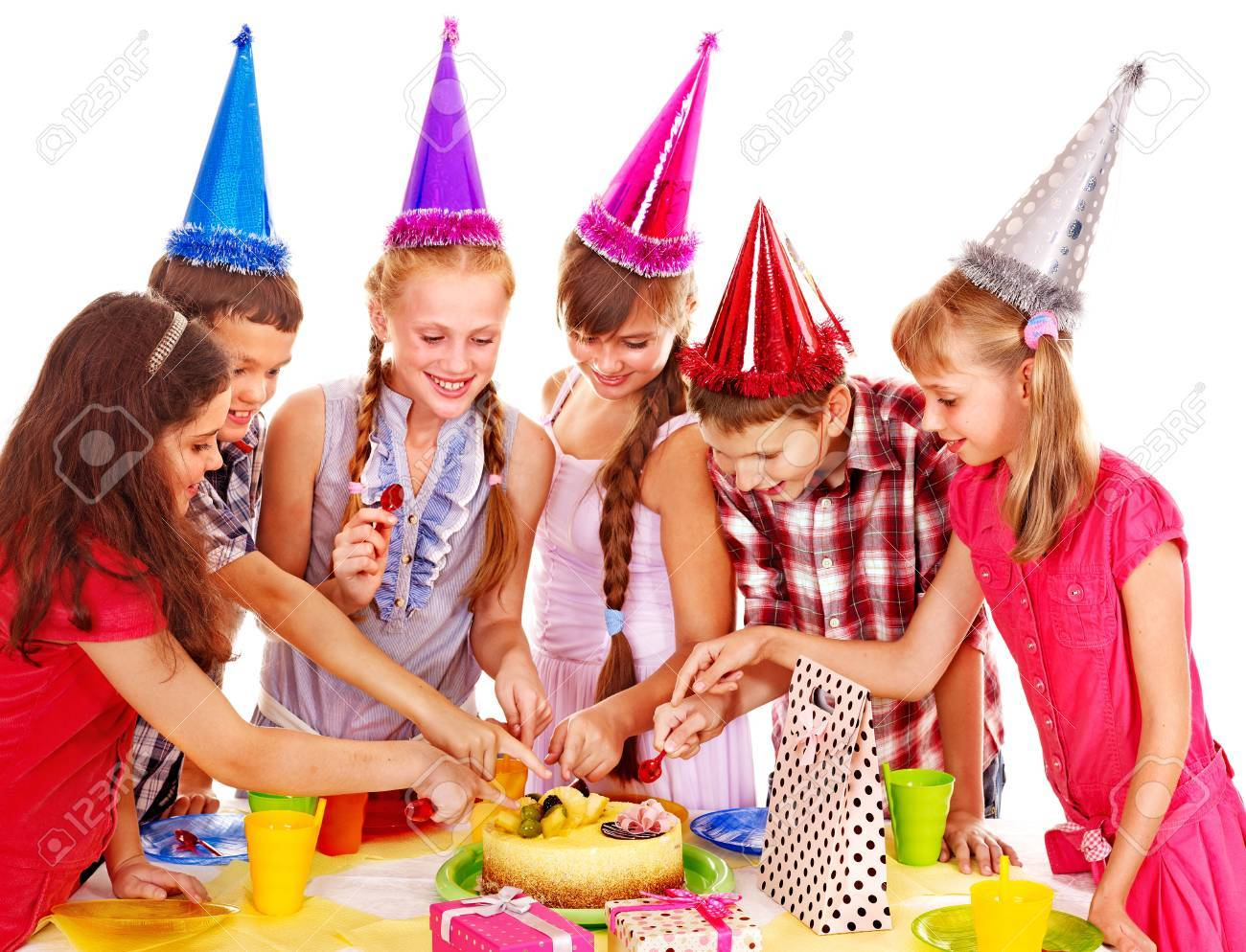 Birthday party of group teen with cake. Isolated. Stock Photo - 15635162