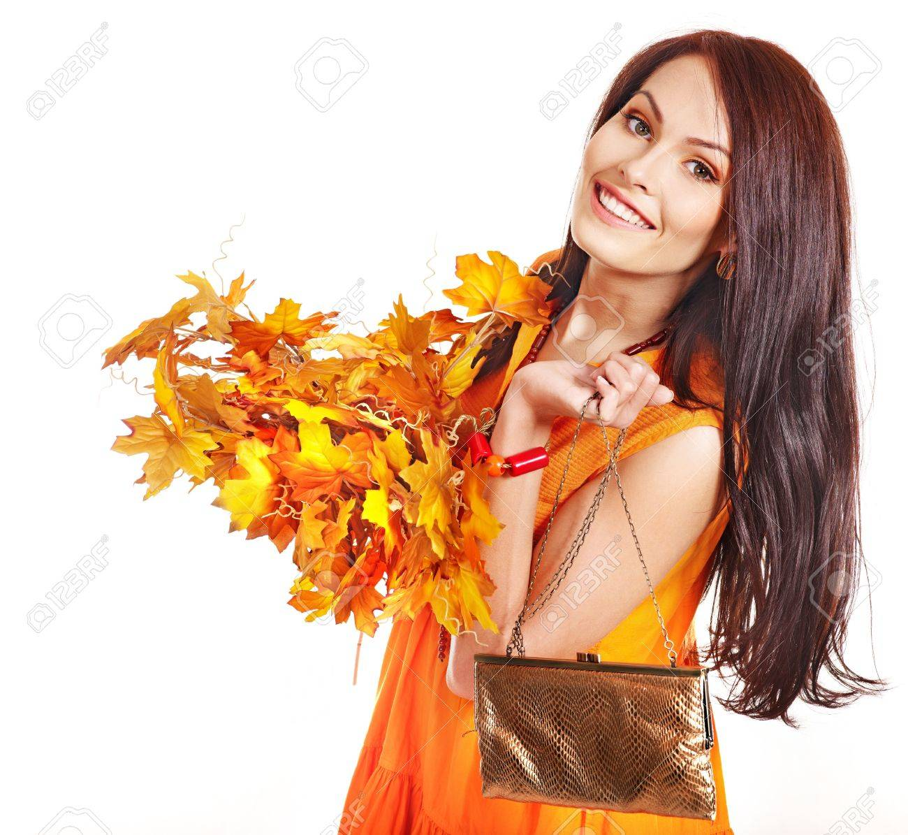 Woman holding  orange leaf and handbag. Autumn fashion. Stock Photo - 15635189