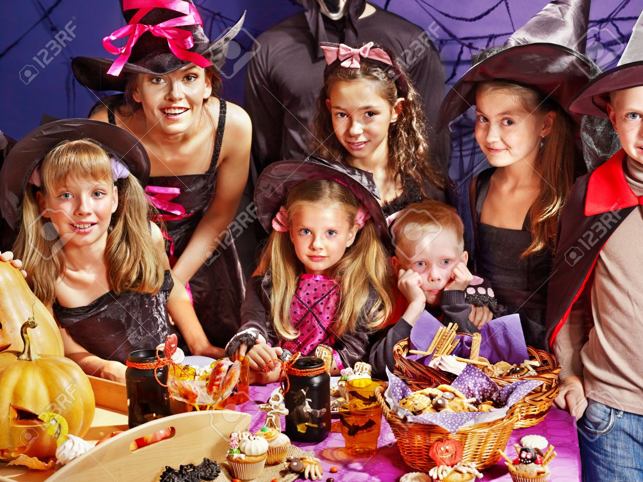 Children on Halloween party  making carved pumpkin Stock Photo - 15635191