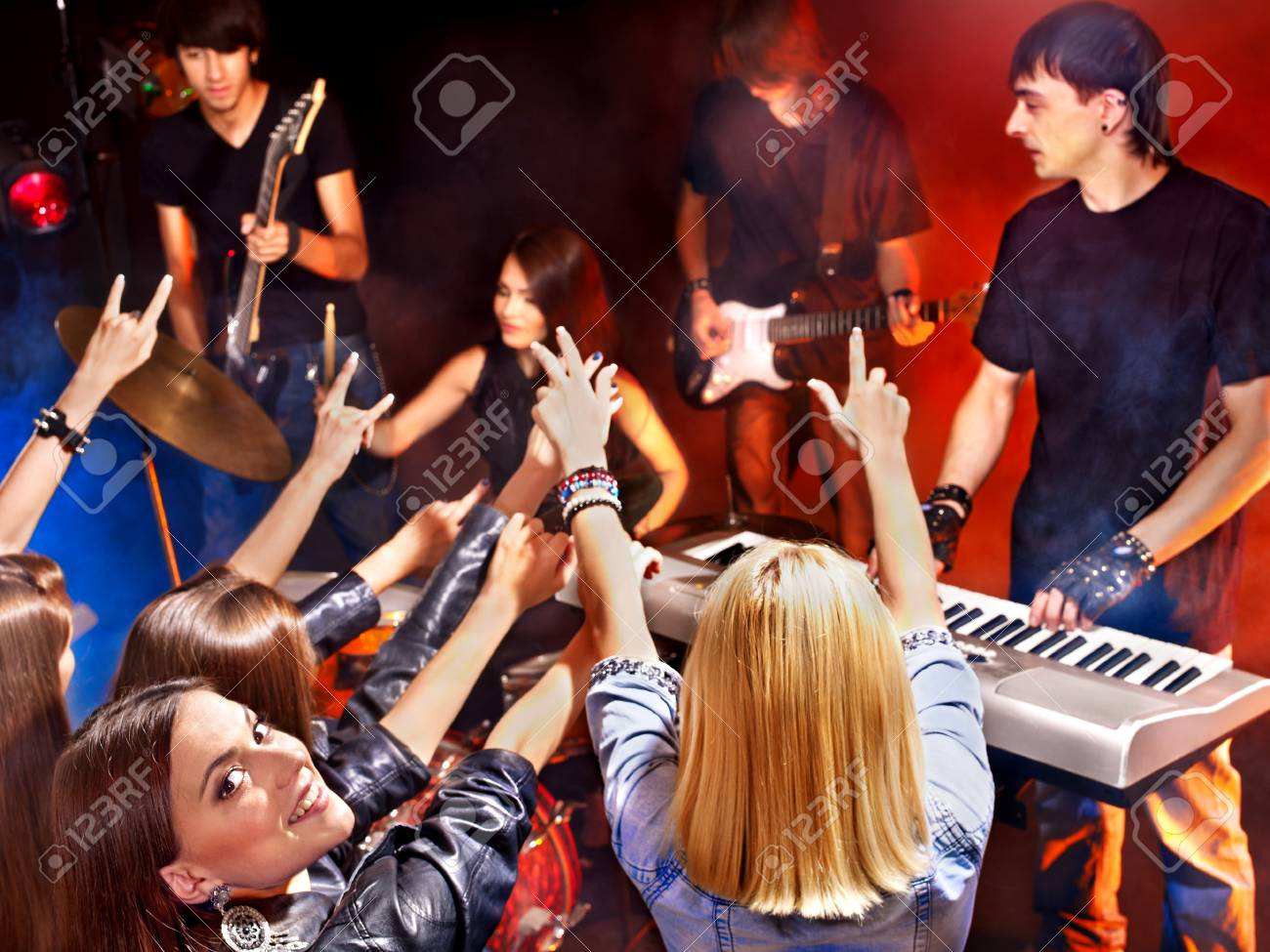 Musical group male and female  performance in night club. Stock Photo - 15718973