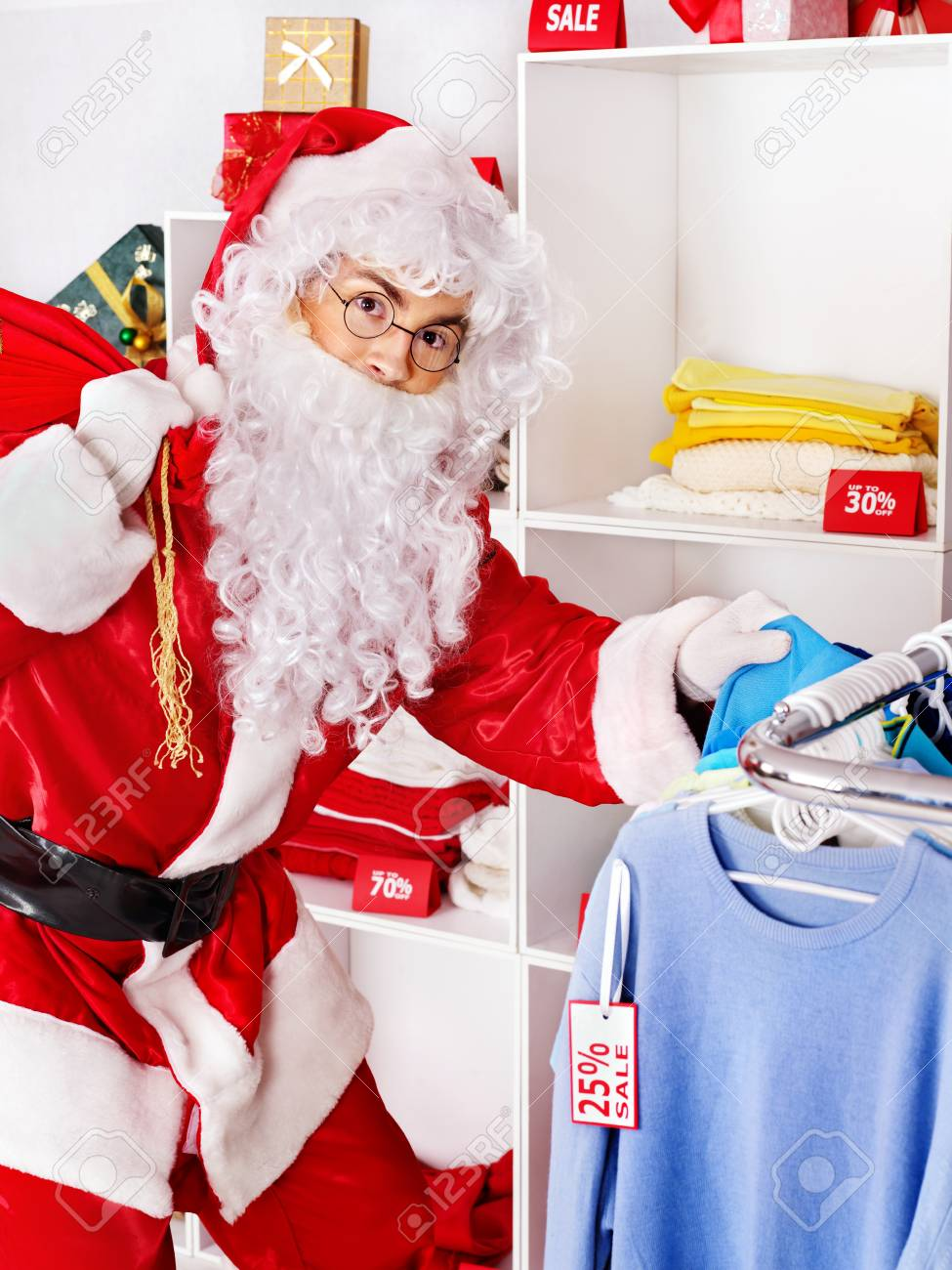 Santa Claus in clothing store. Christmas sale. Stock Photo - 16354973