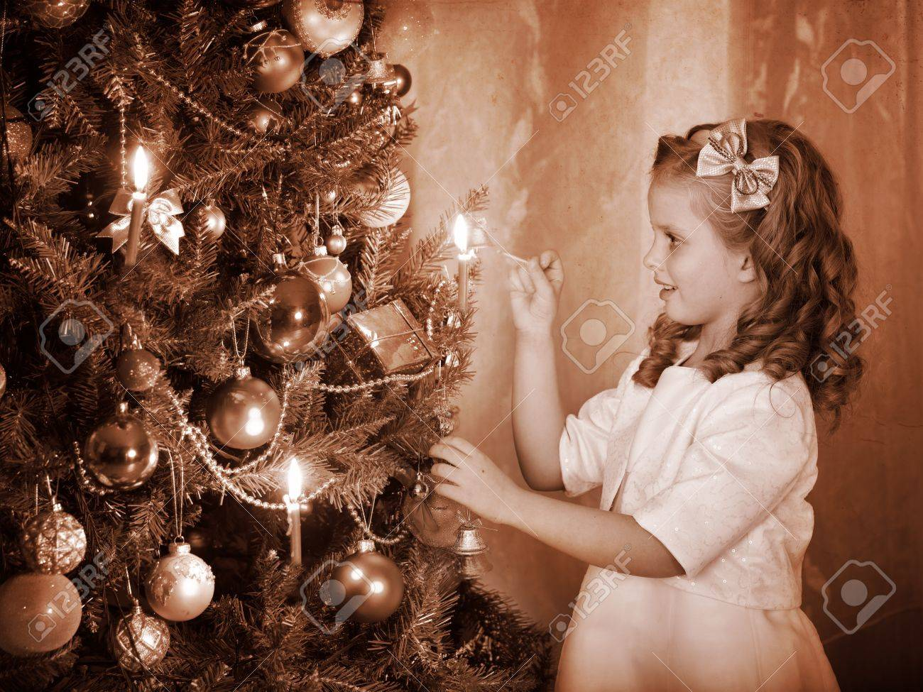 Little Girl Lights Candles On Christmas Tree. Black And White ...