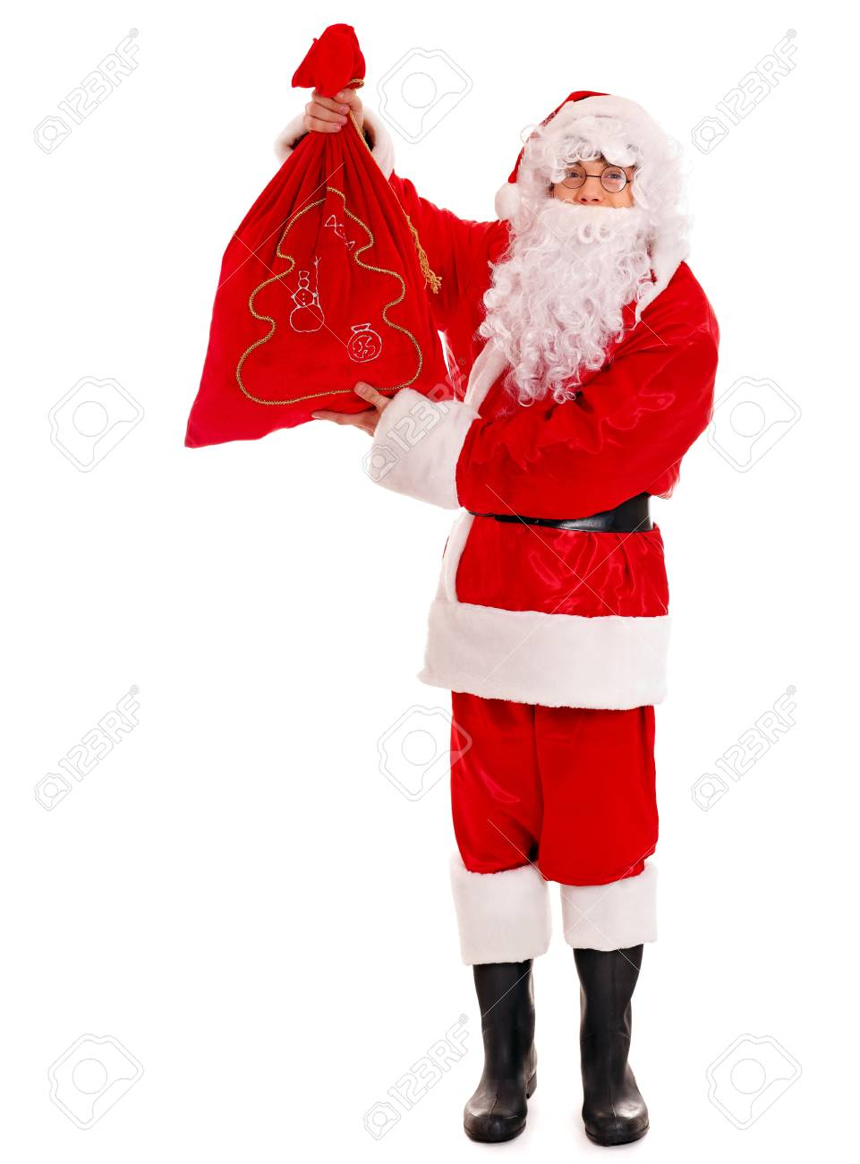 Santa Clause holding gift. Isolated. Stock Photo - 16609936