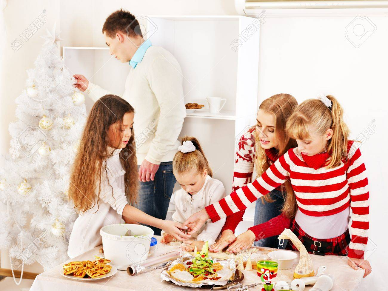 Christmas Kitchen Happy Family With Children Rolling Dough In Christmas Kitchen