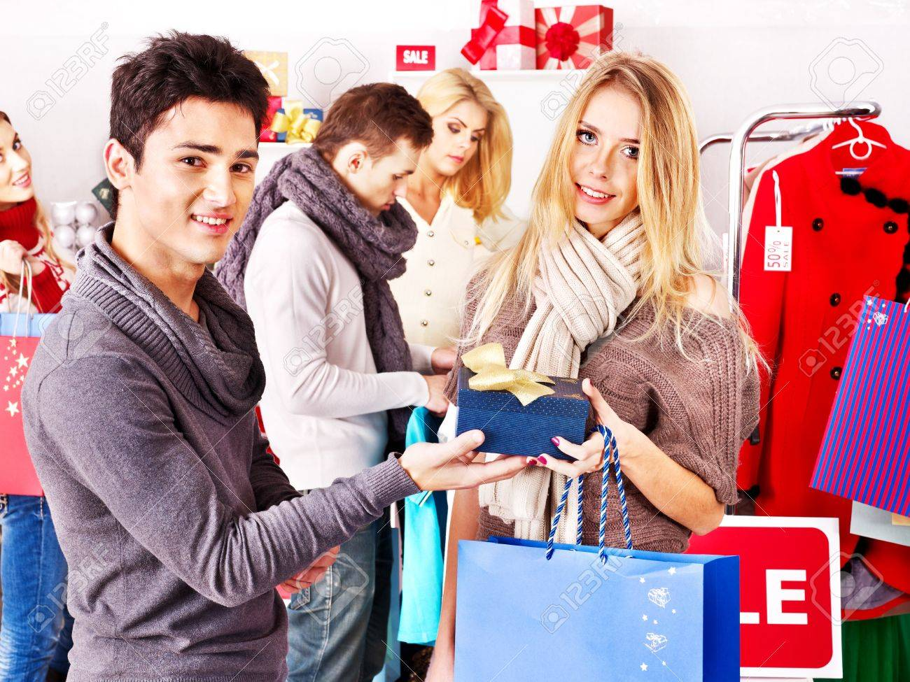 0d994b0cae Shopping group people at sales in clothing store. Stock Photo - 16610316