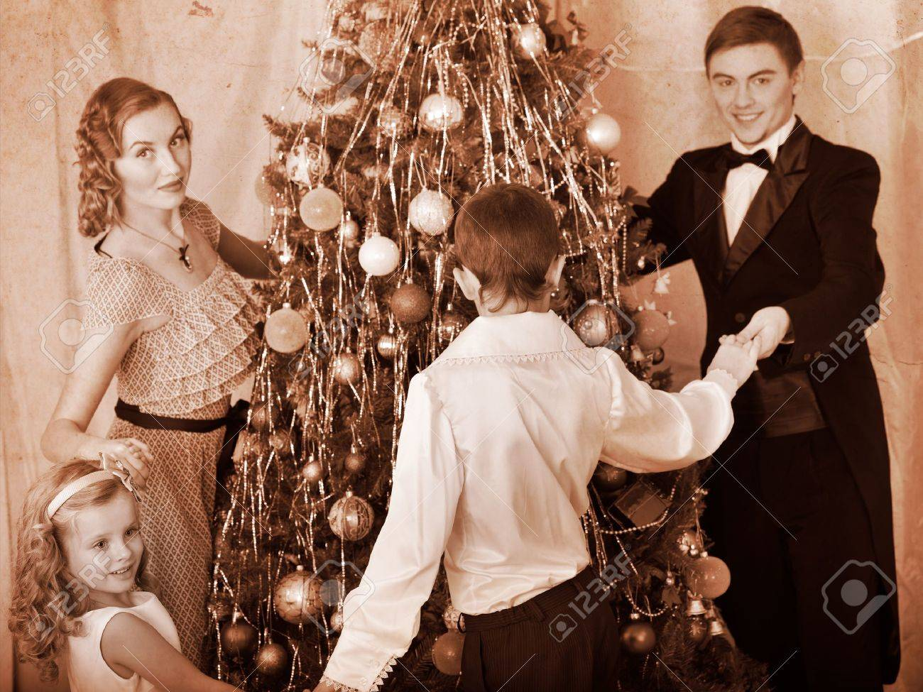 Happy family with children round dance  Christmas tree. Black and white retro. Stock Photo - 16610274
