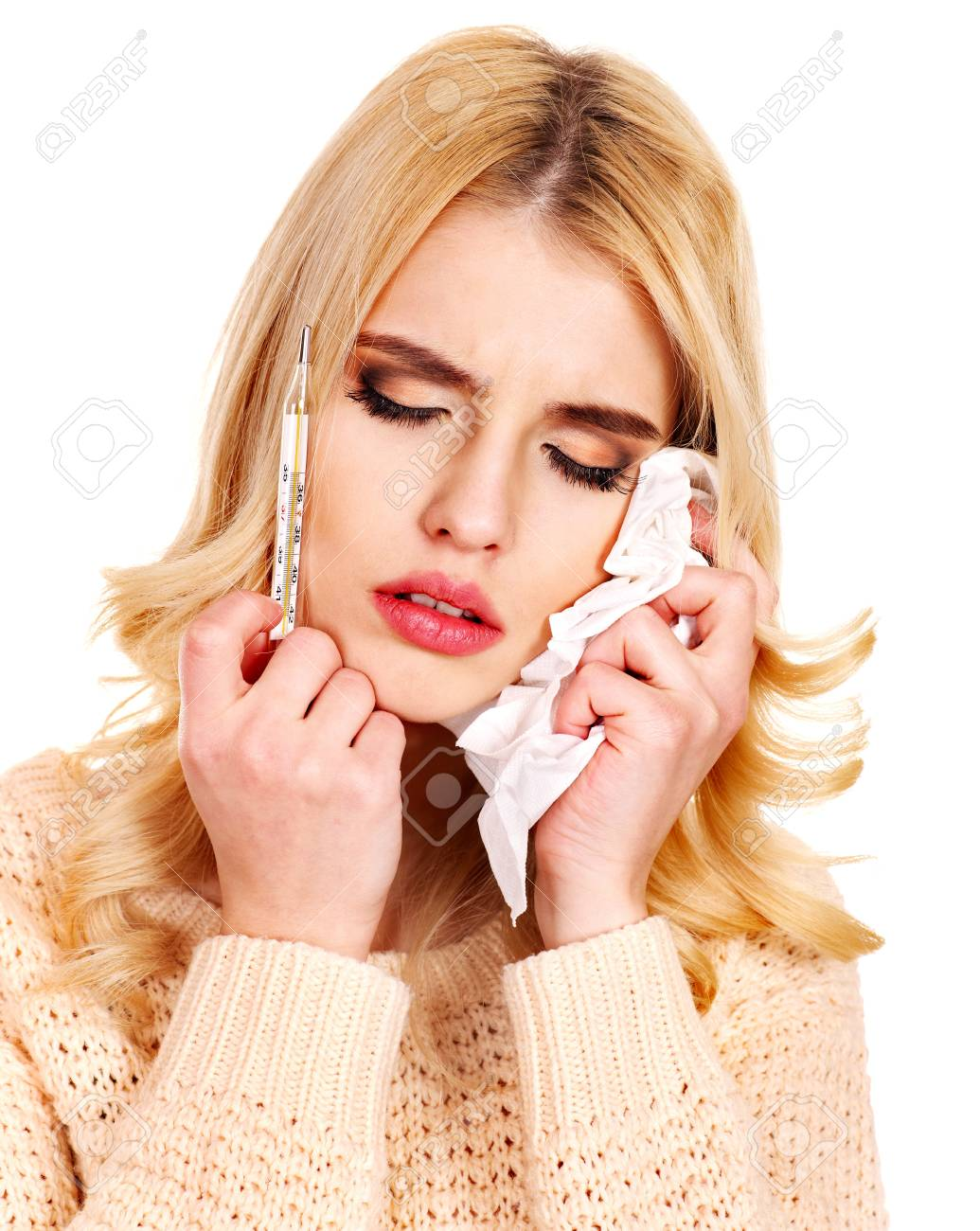 Young woman having  flue taking thermometer. Isolated. Stock Photo - 17533029