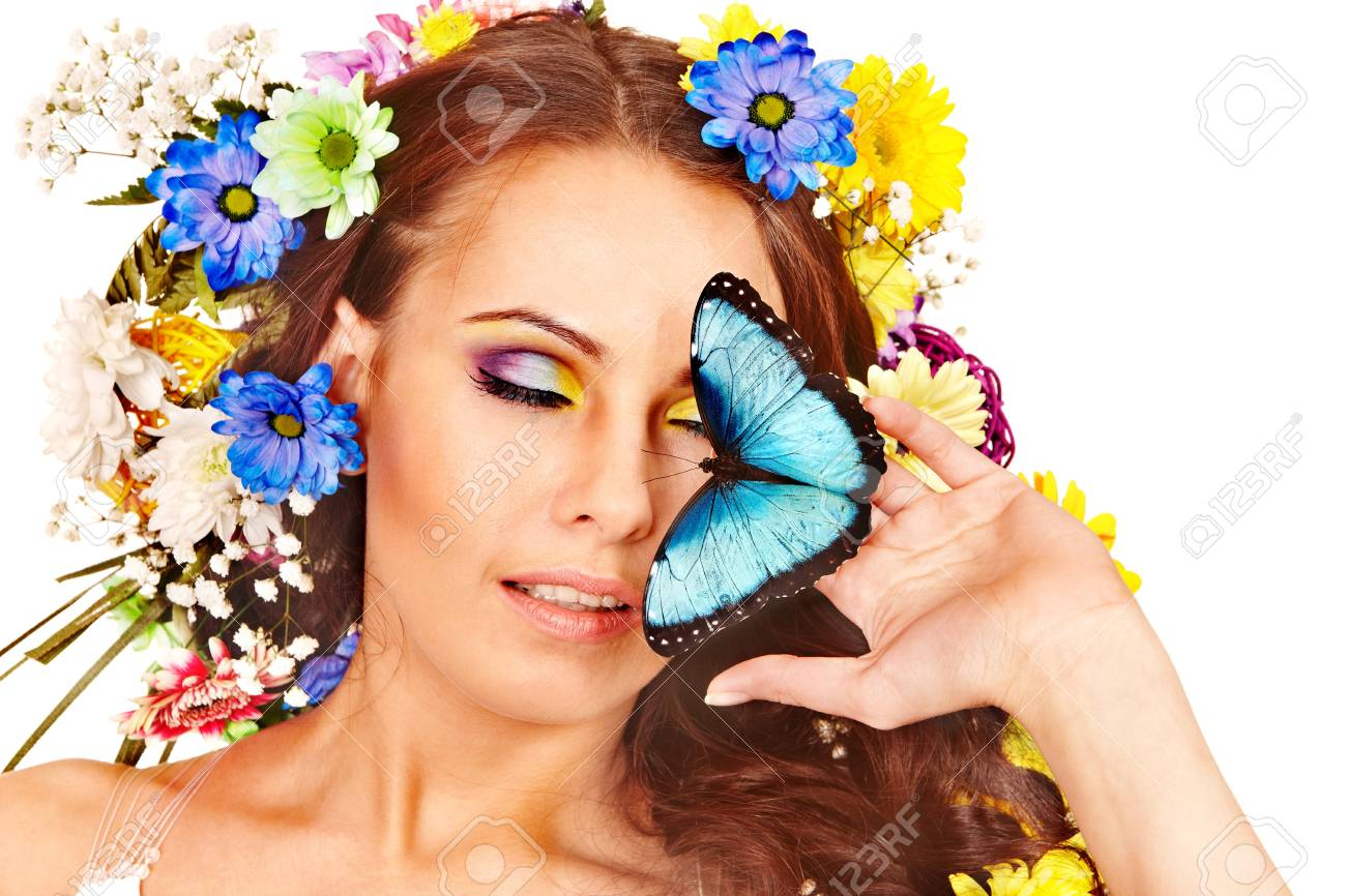 Woman with  flower and  butterfly. Isolated. Stock Photo - 17753902