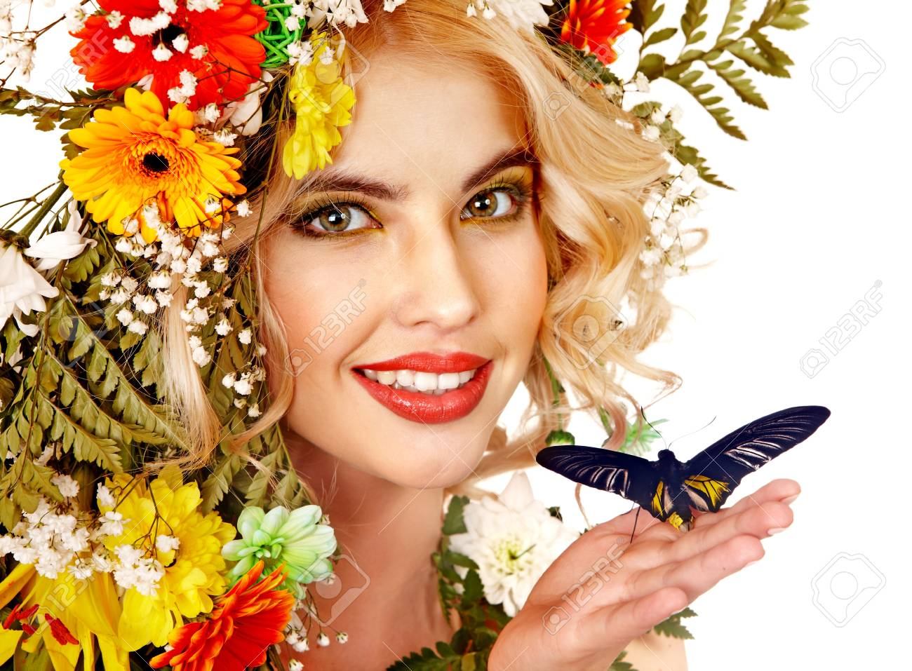 Woman with  flower and  butterfly. Isolated. Stock Photo - 17753822