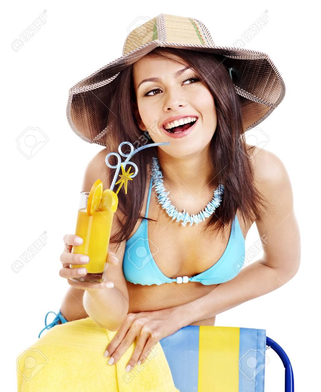 Girl in bikini drink juice through  straw. Isolated. Stock Photo - 17753898