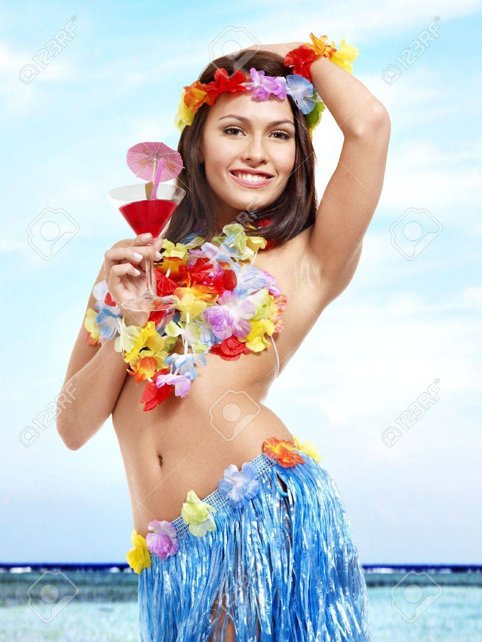 Young woman in hawaii costume drink  juice. Stock Photo - 17753871