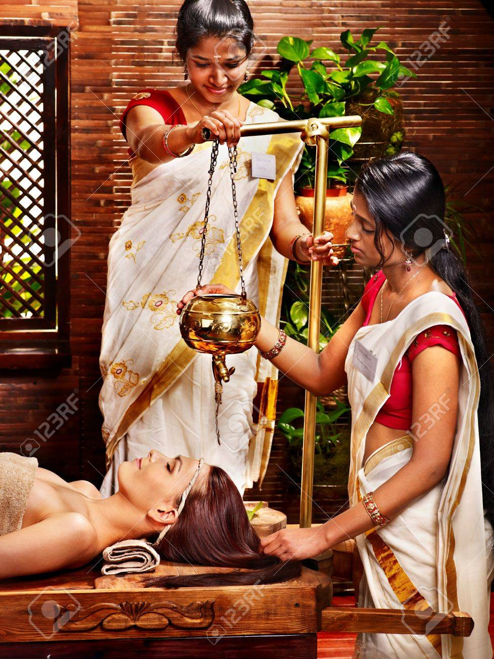 Young woman having oil Ayurveda spa treatment. Stock Photo - 17795857