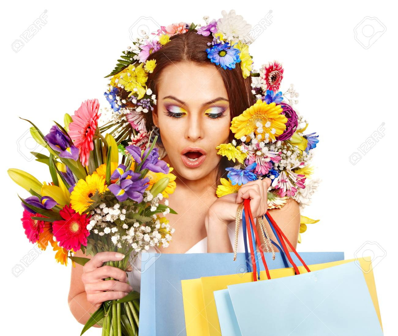 Woman with shopping bag holding flower. Isolated. Stock Photo - 17966814