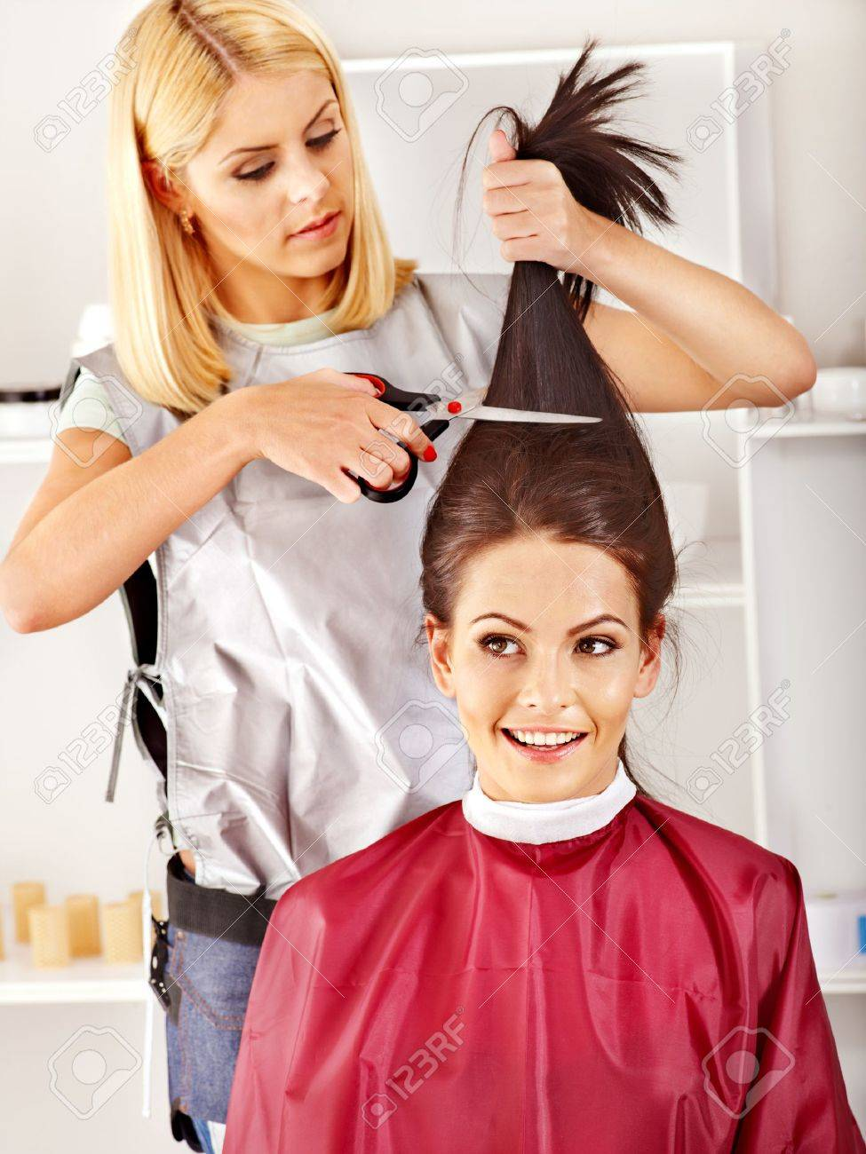 Woman at hairdresser with iron hair curler. Stock Photo - 17967327