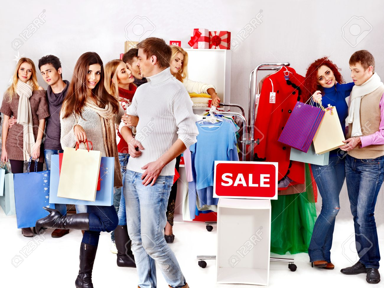 bc19fa0641 Shopping group people at sales in clothing store. Stock Photo - 18636200
