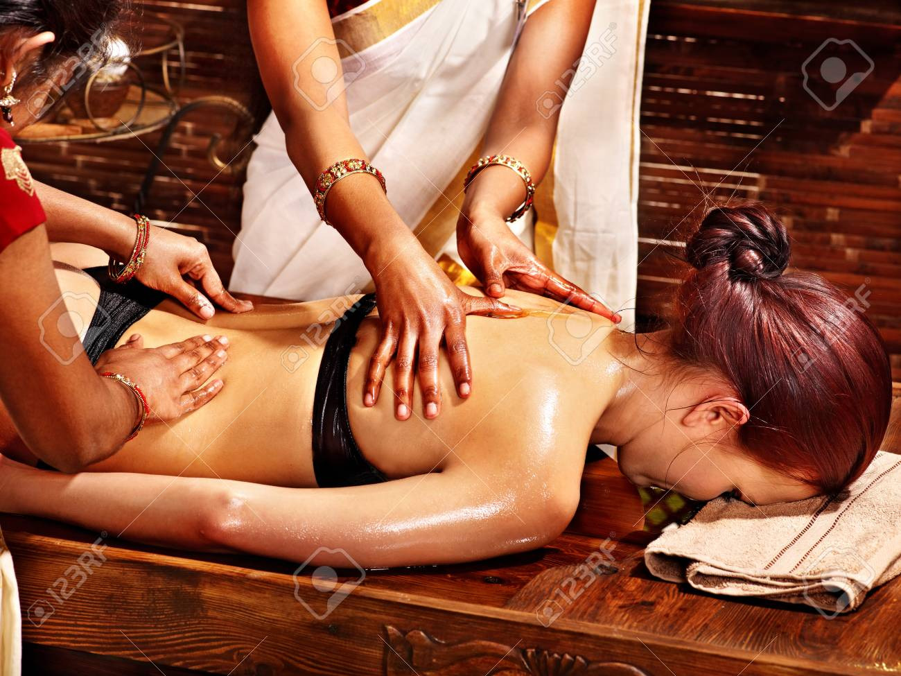 Young woman having oil Ayurveda spa treatment. Stock Photo - 18664827