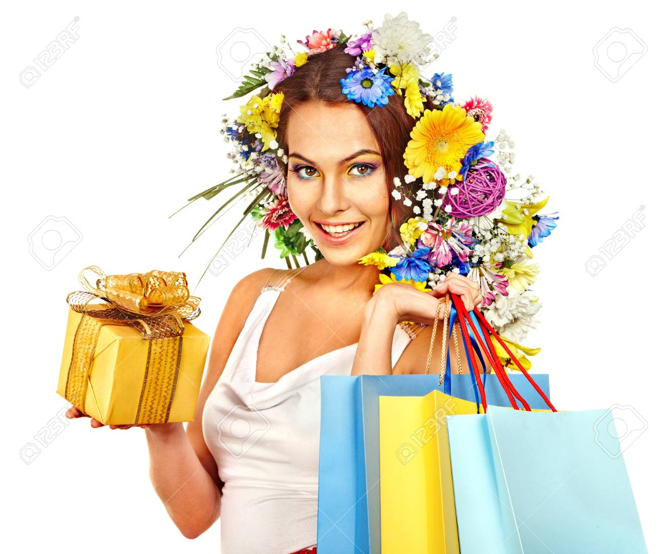 Woman with shopping bag holding flower. Isolated. Stock Photo - 18810881