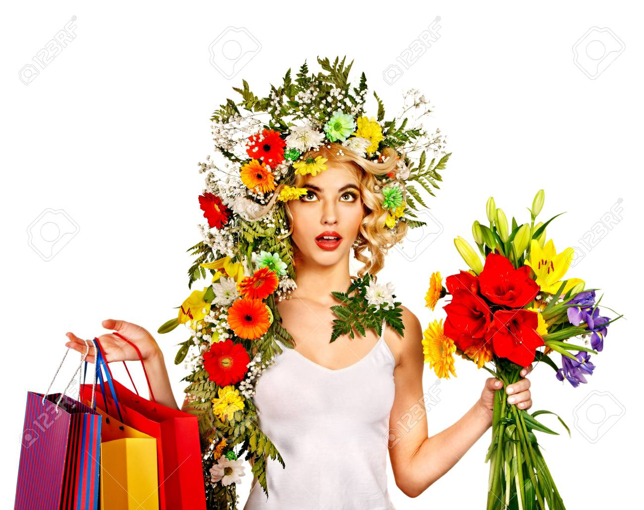 Woman with shopping bag holding flower. Isolated. Stock Photo - 18810894