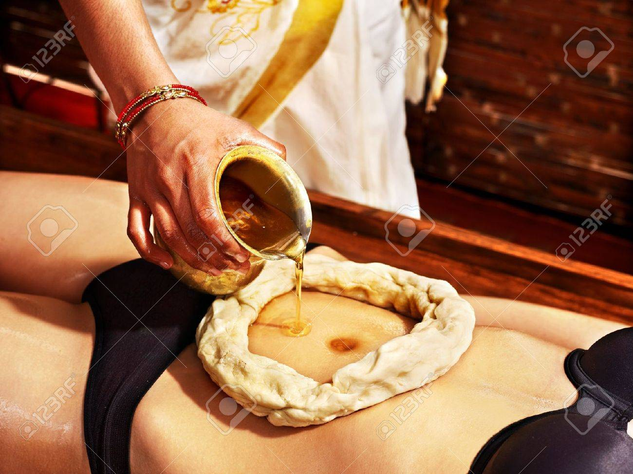 Young woman having stomach Ayurveda spa treatment. Stock Photo - 18795836