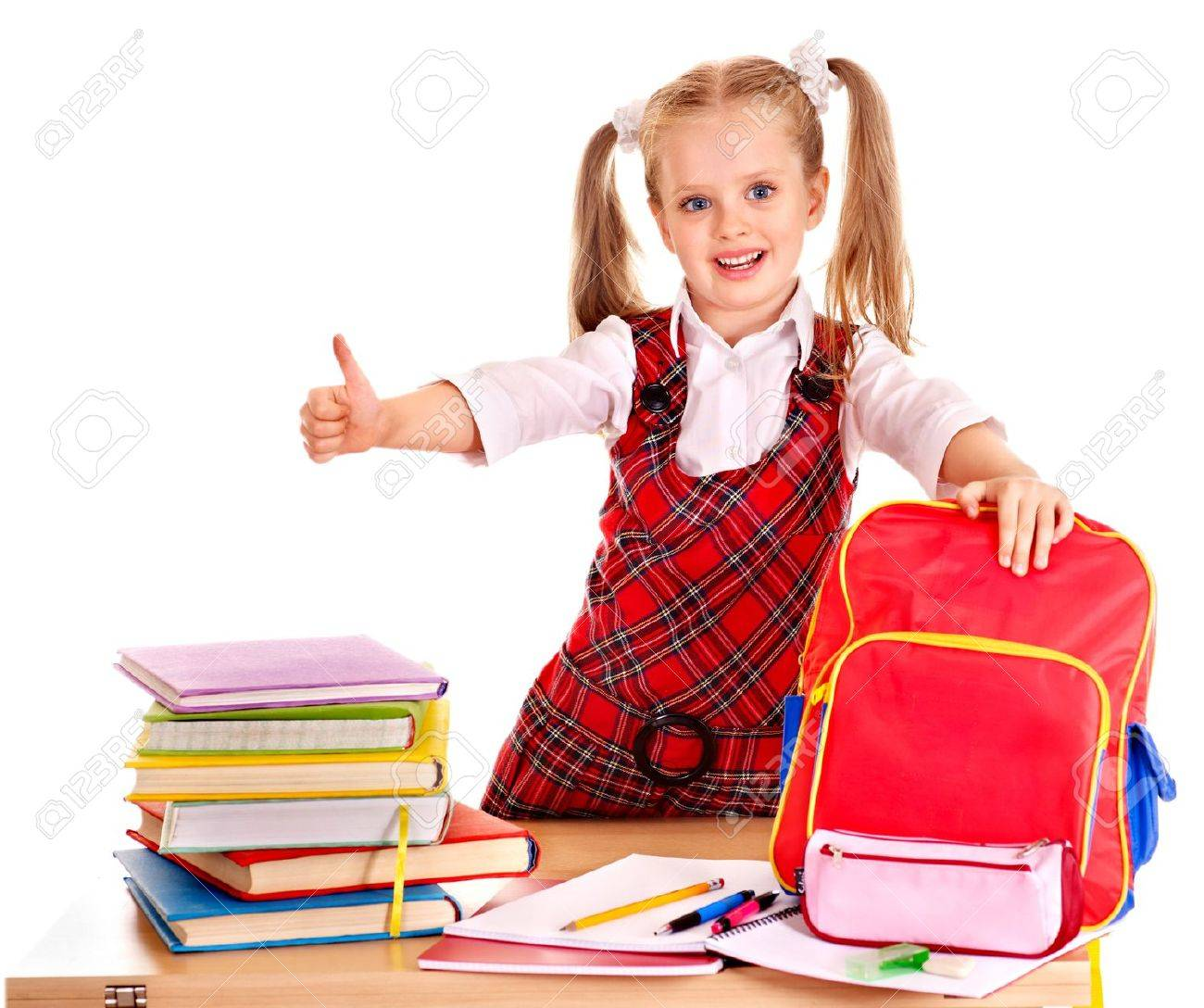 Child with school supplies and book. Isolated. Stock Photo - 19556272