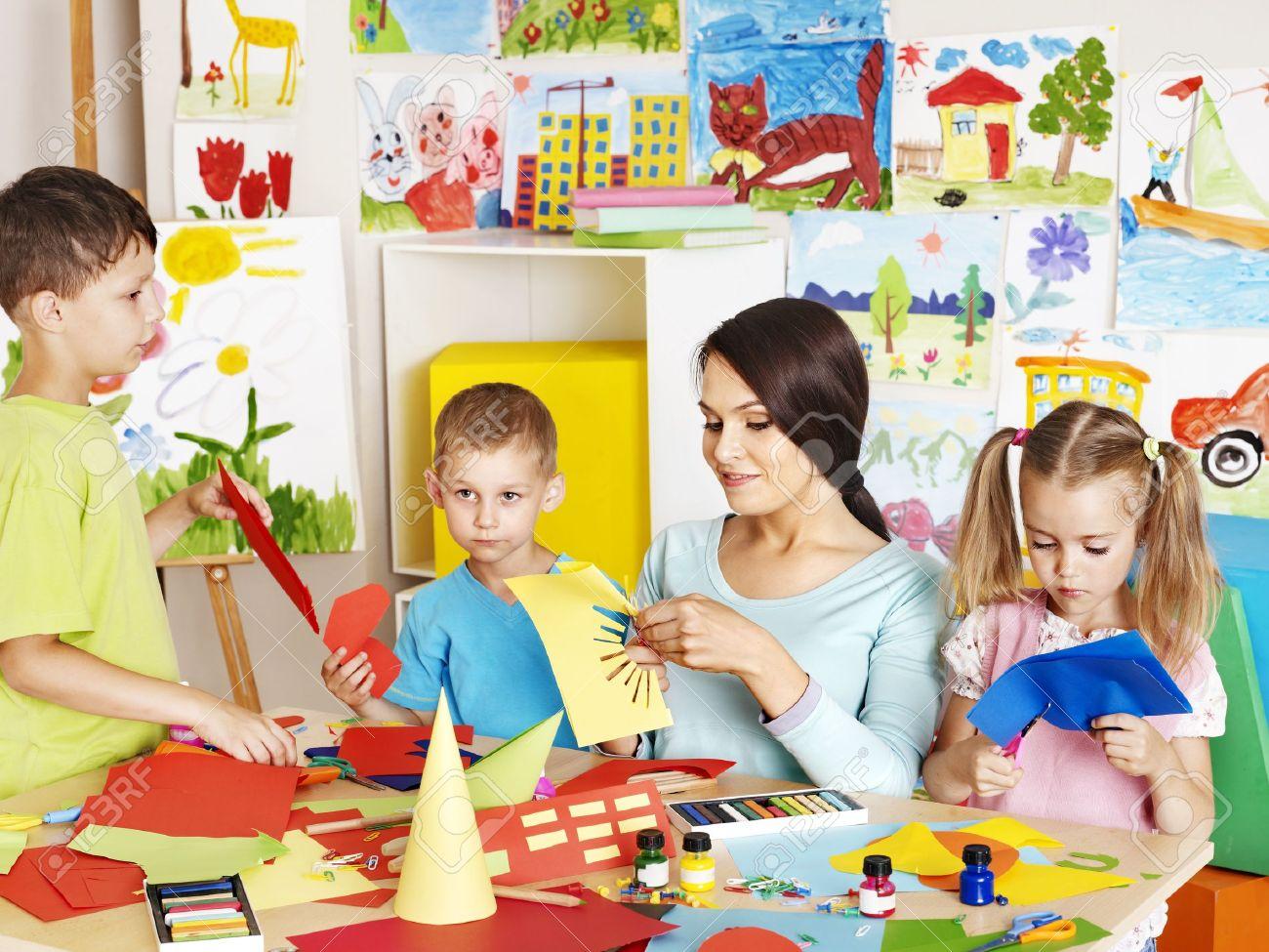 Happy children  with scissors at classroom. Stock Photo - 20724439
