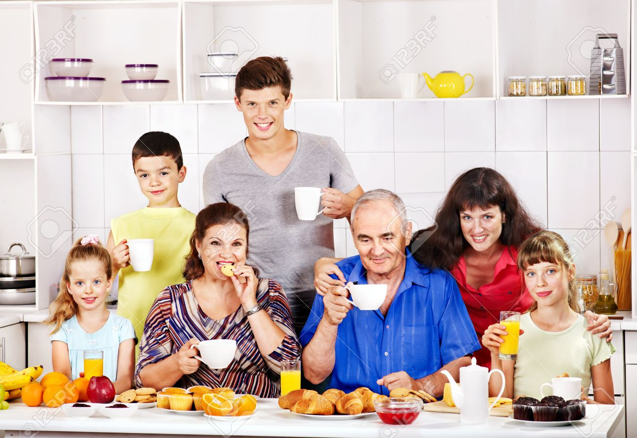 Happy family in kitchen - Big Happy Family Have Breakfast At Kitchen Stock Photo 21173855