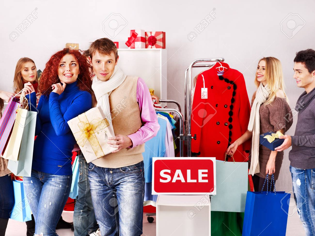 ccf16c99b4 Shopping group people at sales in clothing store. Stock Photo - 21733956