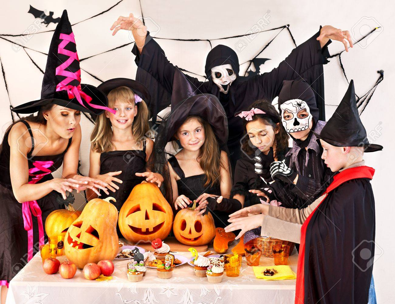 Halloween party with group children holding trick or treat. Stock Photo - 21894865